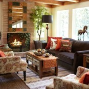 bright printed pillows, a printed rug, a bright framed mirror are cool for adding a fall feel to the space