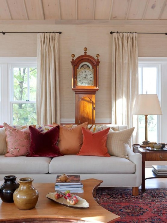 bright jewel-toned pillows and a bold printed rug are an easy and budget-friendly way to add a fall feel to the space