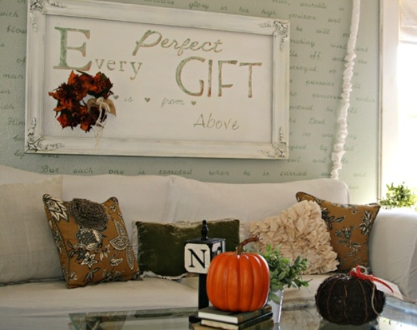 printed fall colored pillows and pumpkins add a fall touch to the living room