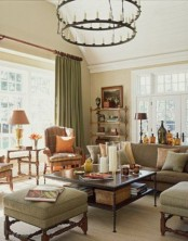 olive green upholstery and textiles make up a relaxing and welcoming fall-colored space