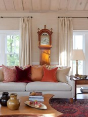 bright fall-colored pillows are enough to bring a fall feel to the living room