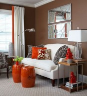 bright orange side tables, pillows and curtains will add fall flavor to the space decor