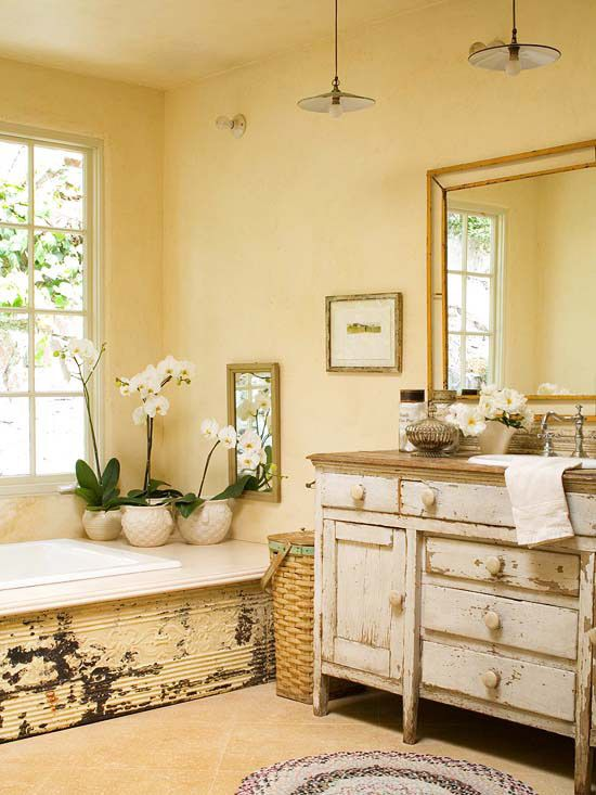 a shabby chic farmhouse with shabby furniture, a bathtub clad with shabby wood, sandy walls and sandy tiles on the floor