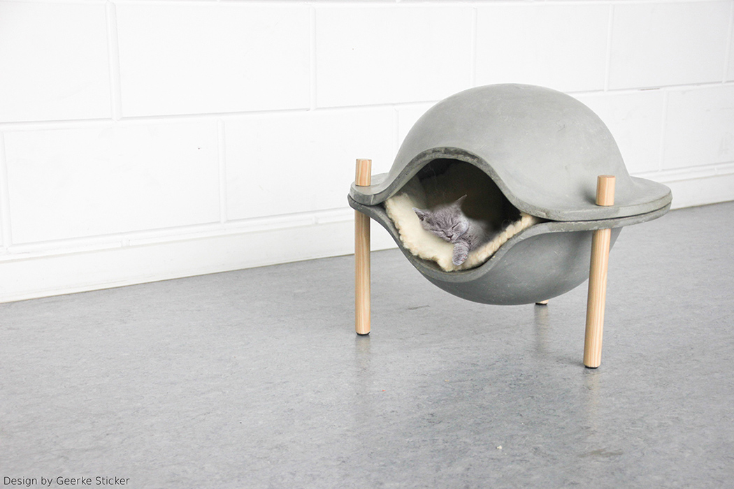 Picture Of cozy and stylish concrete pet home on wooden legs  1
