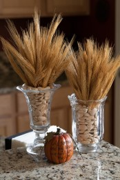 vintage glass vases with wheat and pebbles are gorgeous for centerpieces or just decorations in the fall