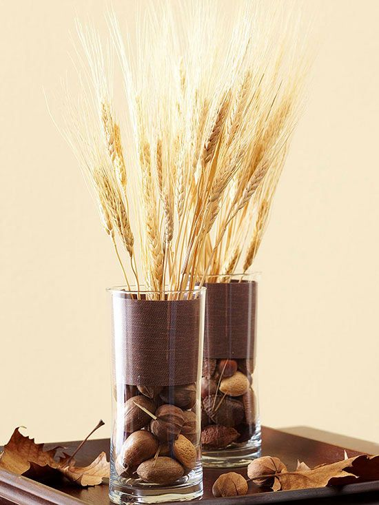 tall glasses with dried blooms and nuts, with chocolate brown fabric and wheat for a centerpiece or just decor