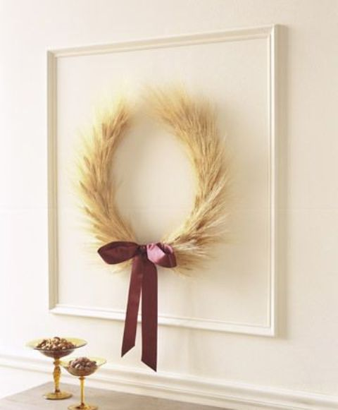 a wheat wreath with a purple ribbon bow for an accent and in a frame will make the space feel like fall