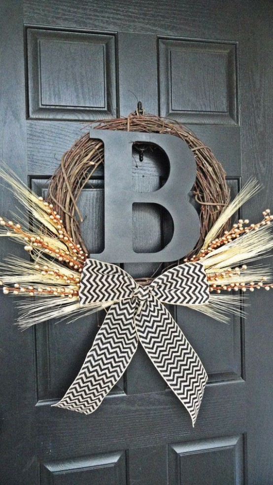 a rustic fall wreath of vine, a monogram, a chevron bow, willow and wheat is a fit for a farmhouse