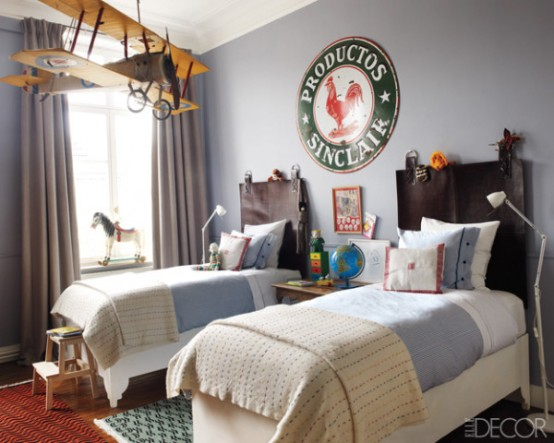 Lovely room for two boys with an awesome vintage decor. A plane hanging from the ceiling is definitely a focal point of the room.