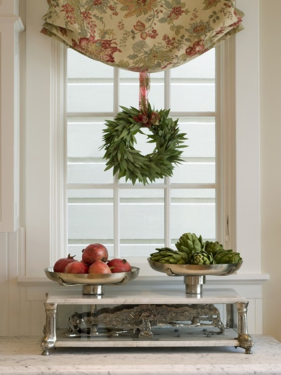 a greenery wreath hung to the curtain makes the space more holiday-like and cool