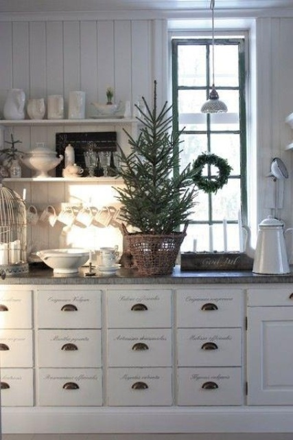 a mini Christmas tree and an evergreen wreath will easily bring a holiday feel to the space