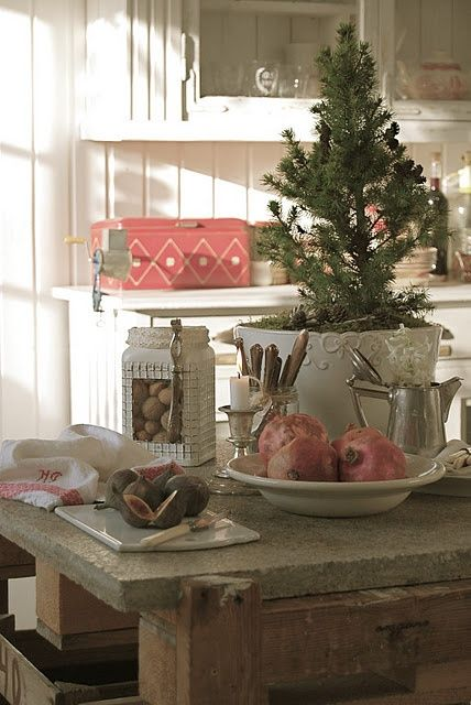 a tabletop Christmas tree, nuts and pomegranates make the kitchen feel like holidays at once