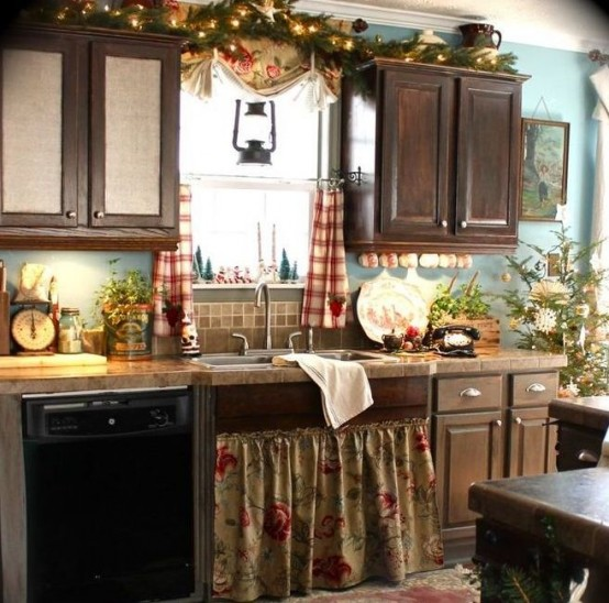 an evergreen and light garland, a Christmas tree, evergreen arrangements and plaid curtains for a holiday feel