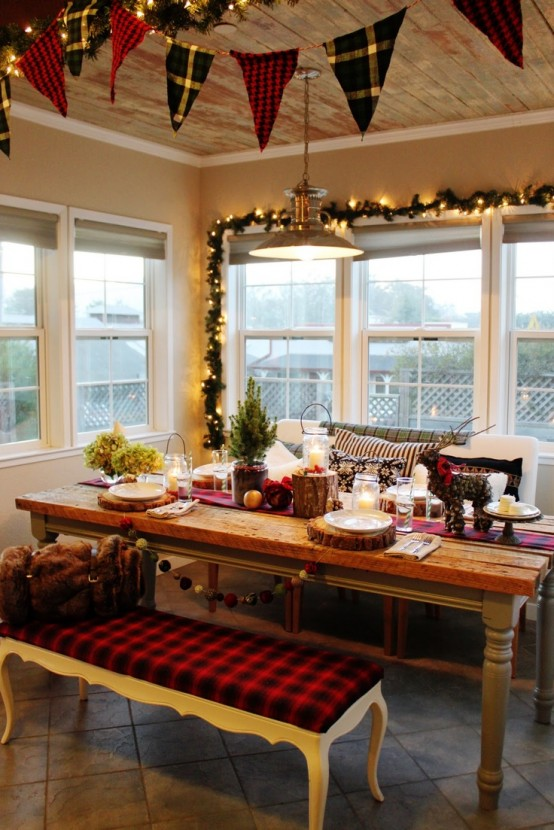 plaid buntings, evergreen and lights garlands, mini Christmas trees, tree stumps and a plaid upholstered bench