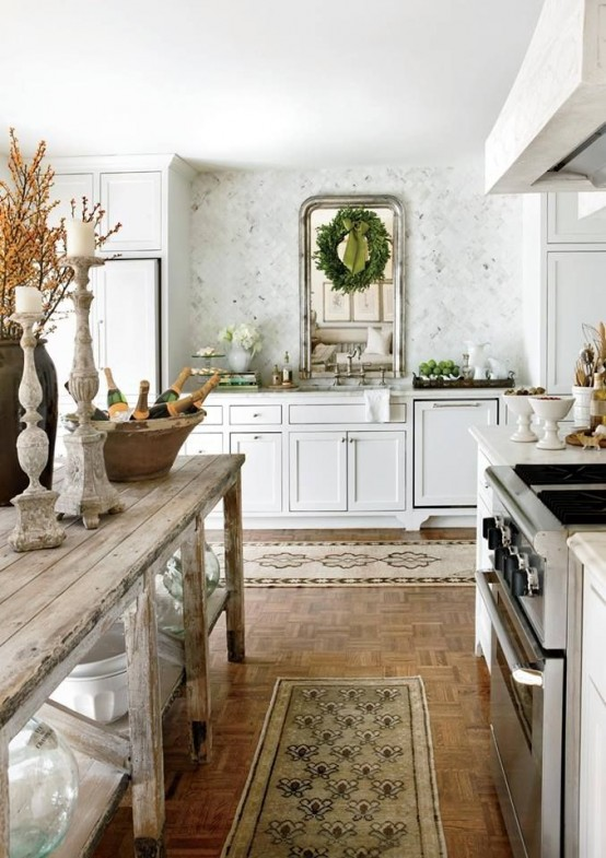 an evergreen Christmas wreath on the mirror makes the kitchen feel like winter holidays