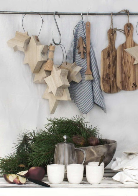 evergreens and pinecones, wooden stars and trees hanging on the holder for a Christmas feel in the kitchen