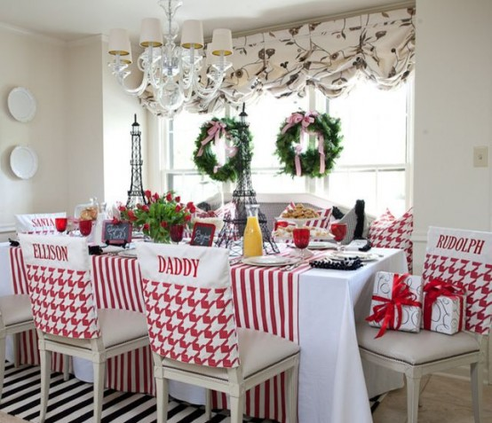 evergreen wreaths with pink bows, red and white linens and gift boxes make the kitchen feel like holidays