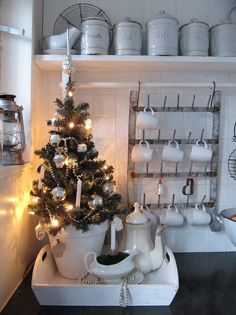 a mini Christmas tree with ornaments and lights will easily create a holiday ambienc in the kitchen