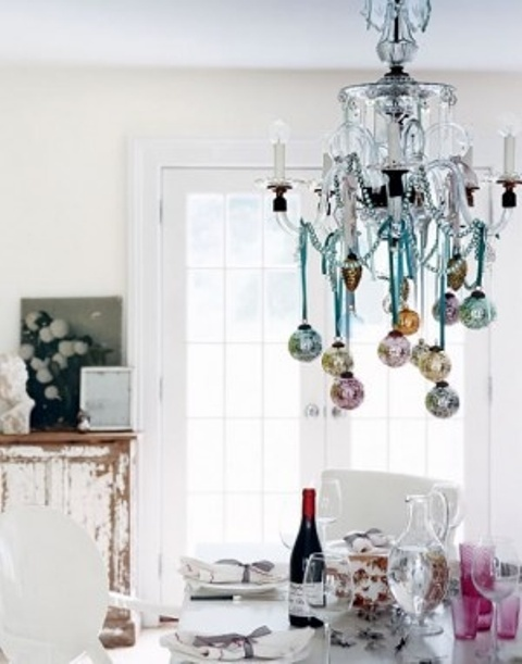 a chandelier with pastel ornaments hanging down is a slight holiday touch to your kitchen