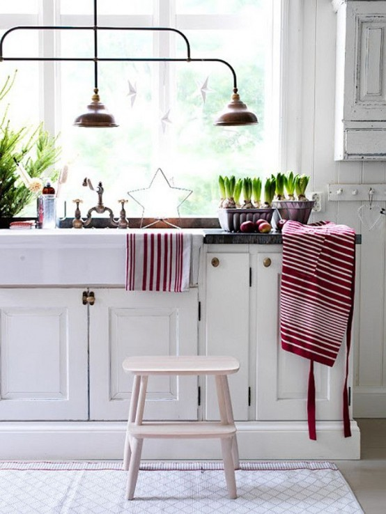 red and white linens, a star, a mini Christmas tree, bulbs for a holiday feel in the kitchen