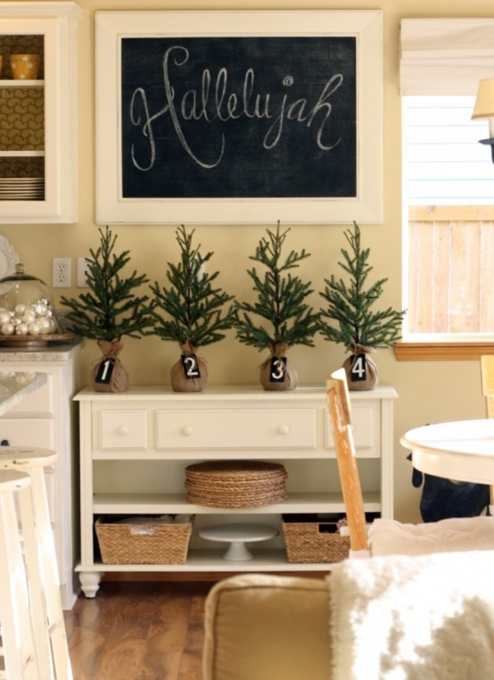mini Christmas trees wrapped in burlap with numbers for Christmas decor in the kitchen