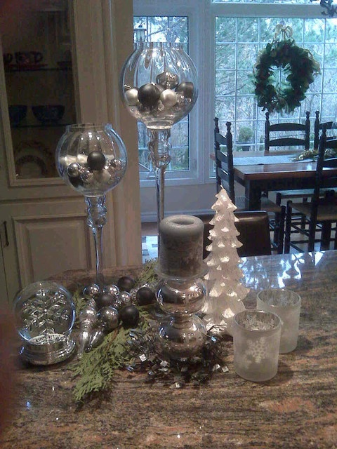 silver and white Christmas decorations, candles, a mini tree and candles for a cool holiday feel in the space