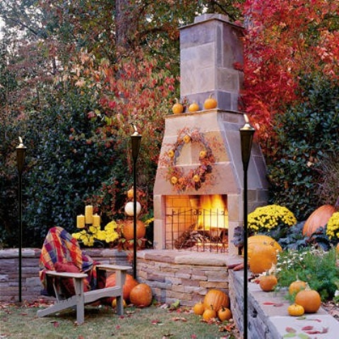 If you patio features a fireplace you can use it as a base for all your outdoor Fall decor.