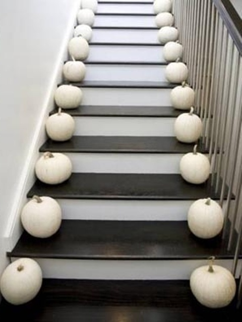 Here is a great idea for a lazy decorator! Put pumpkins on both sides of all steps. You will need a lot of them but how hard can it be to create such display, right?