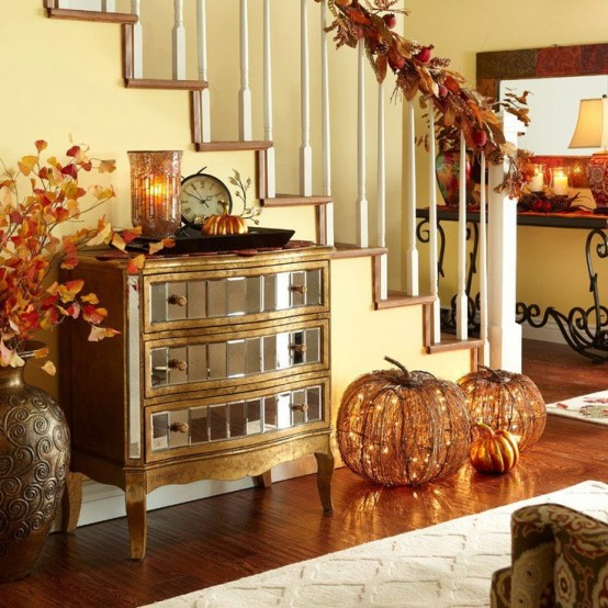 It's a great idea to add something glowing to your stairs decor. In this  case faux twig pumpkins would help to create relaxed ambiance before the Thanksgiving dinner.