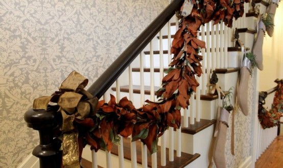 DIY garland of fallen leaves won't hurt your budget but would look great on staircase.