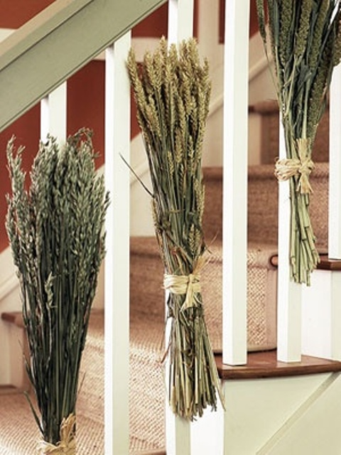 Attach a bunch of long wheat stems to balusters using twine and you're good to go.