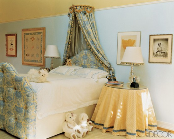 Cozy Girl Bedroom With An Upholstered Bed And Crown Canopy