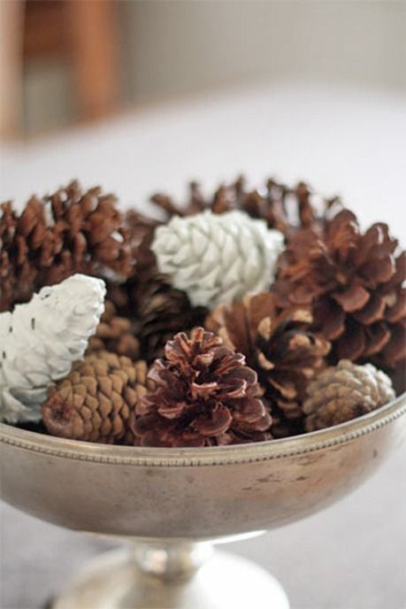 a stylish centerpiece of a vintage bowl filled with usual and whitewashed pinecones is easy to recreate