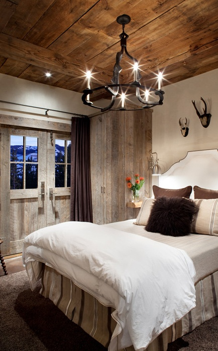 An old-school wrought iron channeller is a perfect light fixture for a rustic bedroom.