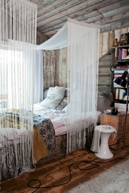 Weathered wood is great but throwing a delicate canopy could make a rom more boho and chic.