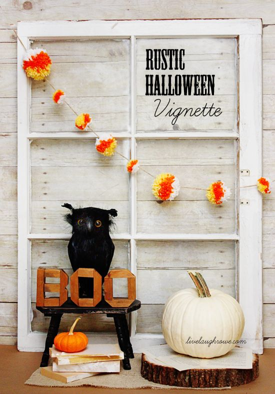 rustic Halloween styling with a window frame, a bold pompom garland, a white pumpkin, an owl and some letters