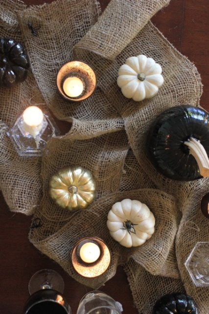 burlap, candles, white and black pumpkins for decorating your home for Halloween in rustic style