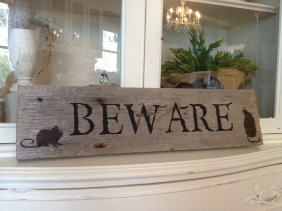 a rustic wooden Halloween sign is a nice decoration and a cool DIY is a great addition to your Halloween decor