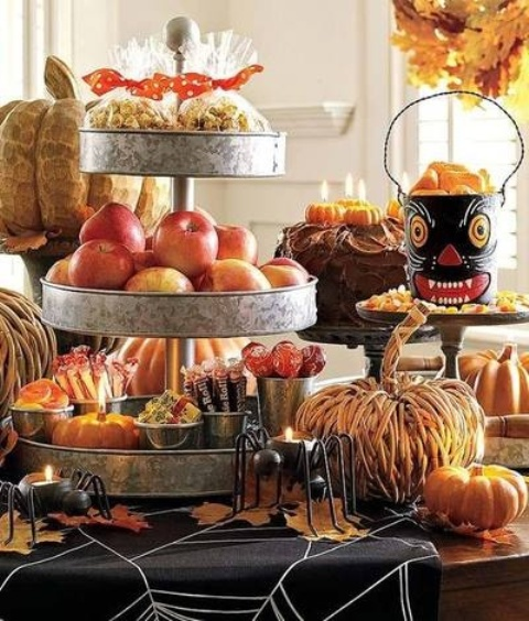rustic dessert table styling with wooden and vine pumpkins, dried leaves, metal tiered stands for fruits and sweets