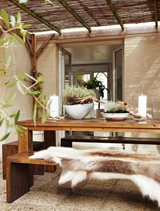 a rustic meets contemporary space with a wooden dining set, a roof and greenery