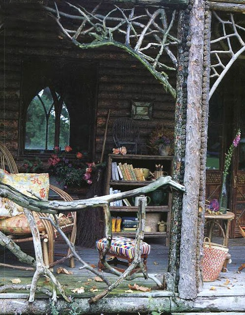 a rustic woodland patio with branch railings, wooden furniture, vintage furniture and potted blooms