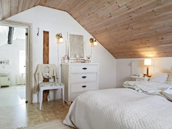 a chic Nordic space done in cremay shades, with neutral stained wood, vintage furniture and lamps and floral upholstery