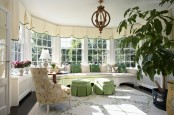 Cozy Sunroom With A Bunch Of Planters