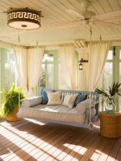 Cozy Sunroom With A Hanging Sofa