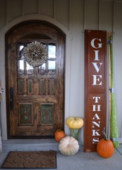 a Thanksgiving sign and some natural pumpkins make the porch inviting and won't take much time to decorate