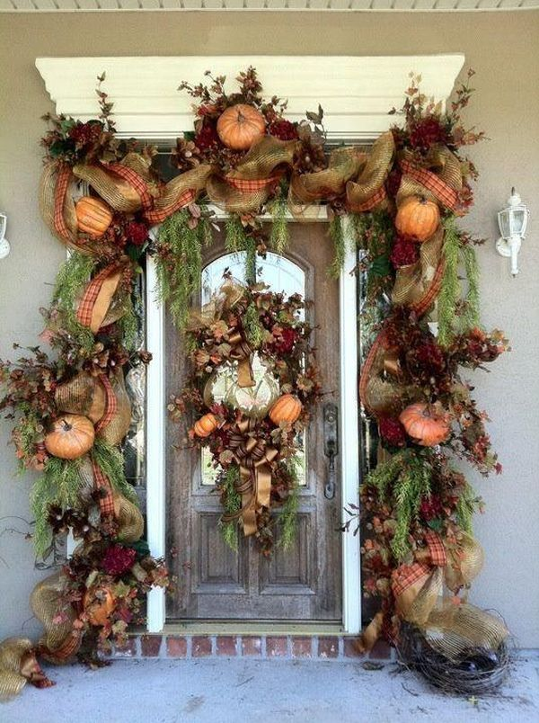 a super lush garland of burlap, plaid ribbons, greenery, fall leaves, faux pumpkins and flowers plus a matching wreath for a refined Thanksgiving front door