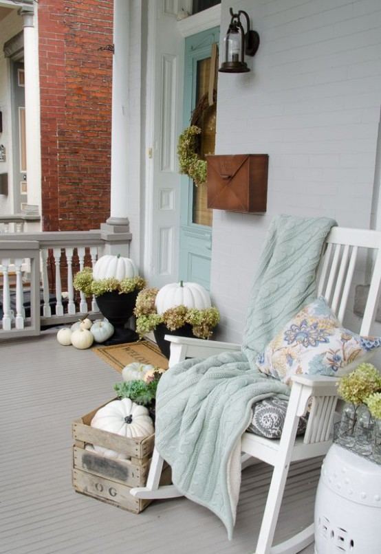 Pumpkins mixed with faux moss could become a great addition to your porch if you put them in planters.