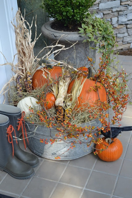 To spice up your outdoor Thanksgiving arrangement use not only pumpkins but indian corn too.