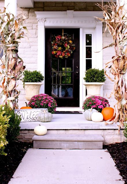 Welcome your family with a bunch of beautiful pumpkins in different colors and fresh fall blooms right on the front porch.