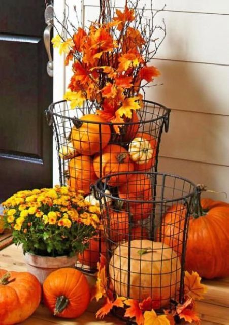Cylindrical wire baskets is a great outdoor alternative to similar glass vases. You can stuff them with pumpkins, gourds, leaves and any other autumn's things.